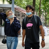 Young Couple with Pink Pig